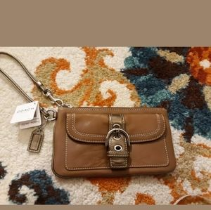 Coach Soho wristlet buckle flap